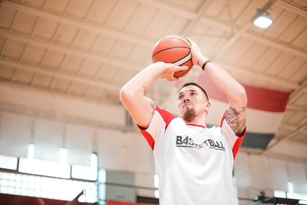 man at basketball practice working on practicing more at his passion