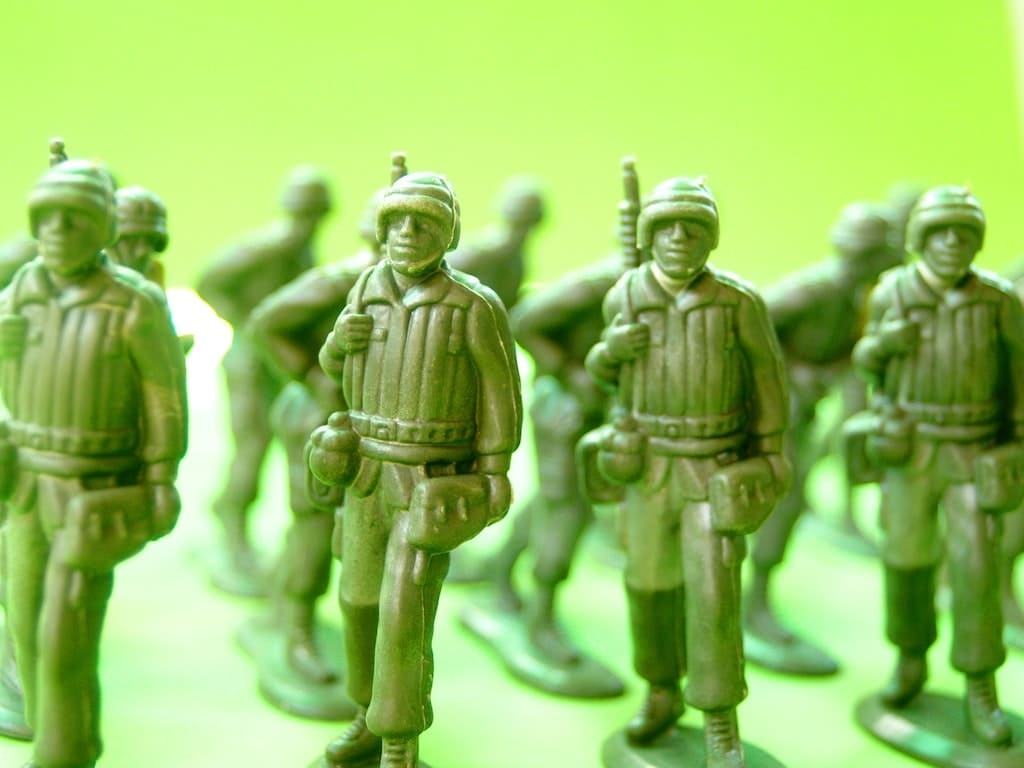 military men toys in rows showing confidence under sufficient leadership