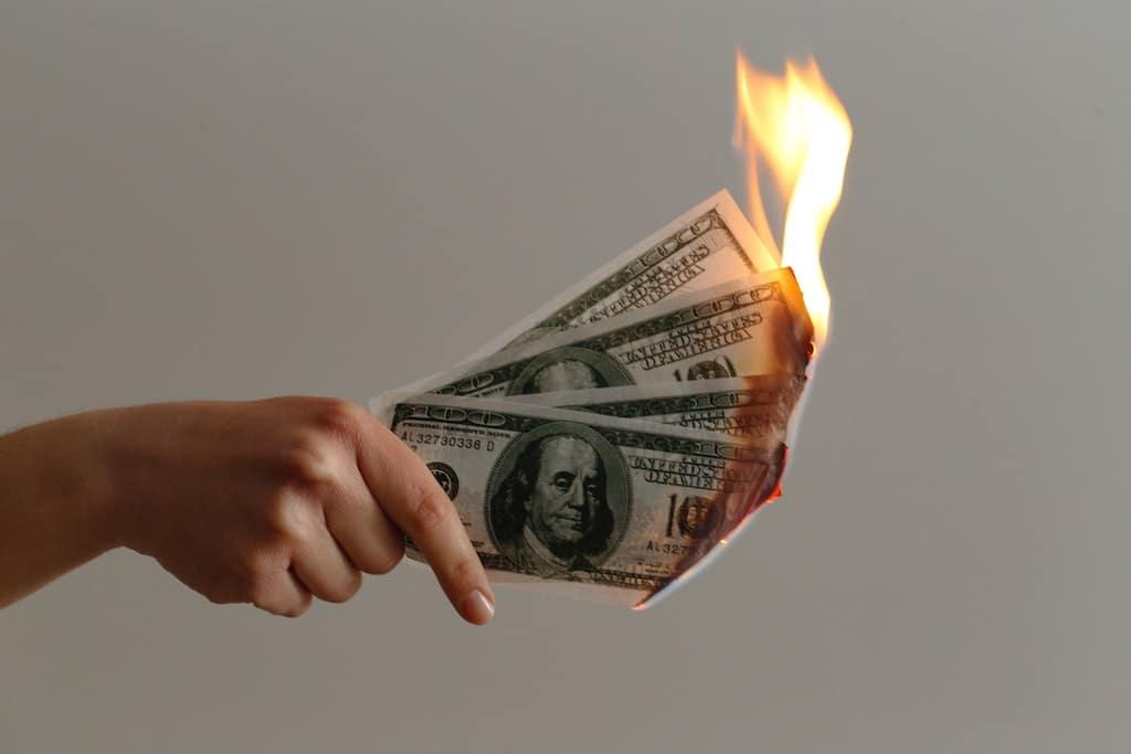 wasting money burning money